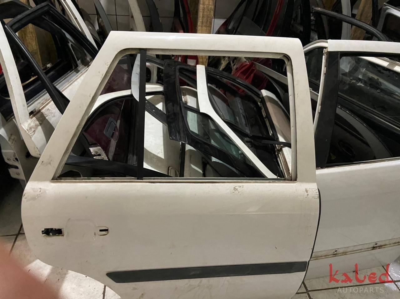 Porta traseira direita Vw Gol Parati G2 G3 G4 branca - Kaled Auto Parts